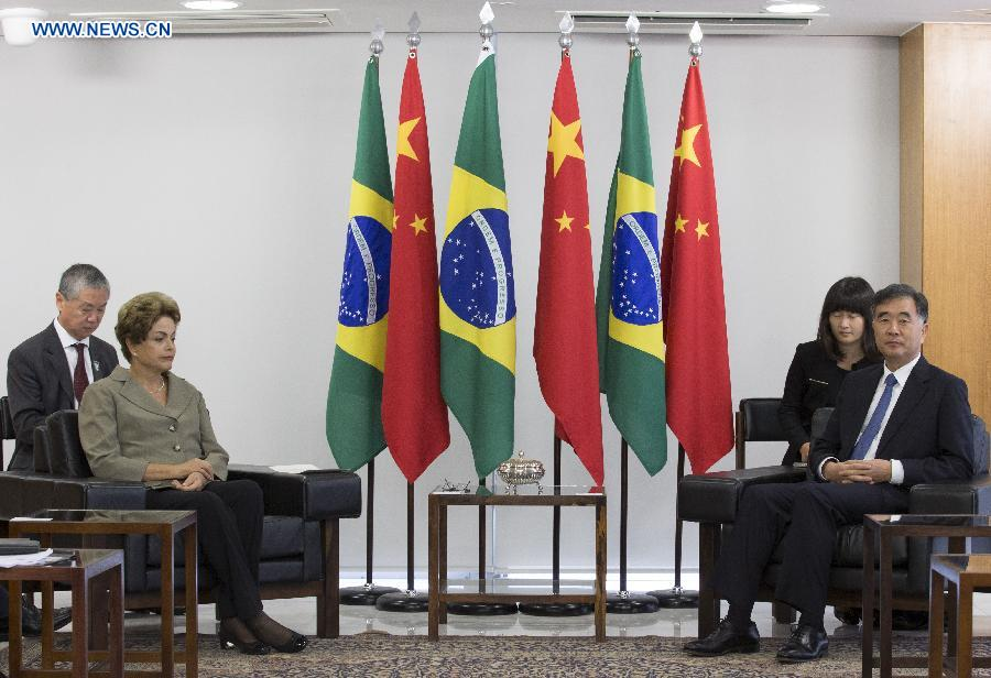 Brazilian President Dilma Rousseff (front, L) meets with Chinese Vice Premier Wang Yang in Brasilia, Brazil, June 26, 2015. (Xinhua/Rong Hao)