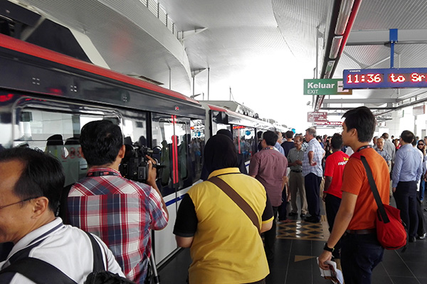 Passengers wait to board the train at Chan Sow Lin Station, a transit platform which is part of the Rapid KL Ampang Line in Malaysia. Trains used on the line were built by CRRC Zhuzhou Electric Locomotive Co Ltd. [Photo provided to China Daily]