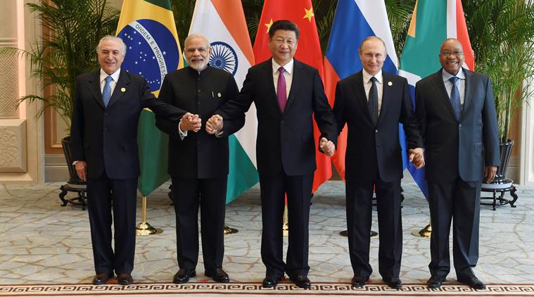 Chinese President Xi Jinping (C) takes a group photo with Indian Prime Minister Narendra Modi (2nd L), Brazil's President Michel Temer (L), Russian President Vladimir Putin (2nd R) and South Africa's President Jacob Zuma at the West Lake State Guest House ahead of G20 Summit in Hangzhou, Zhejiang province, China, September 4, 2016. REUTERS/Wang Zhao/Pool     TPX IMAGES OF THE DAY